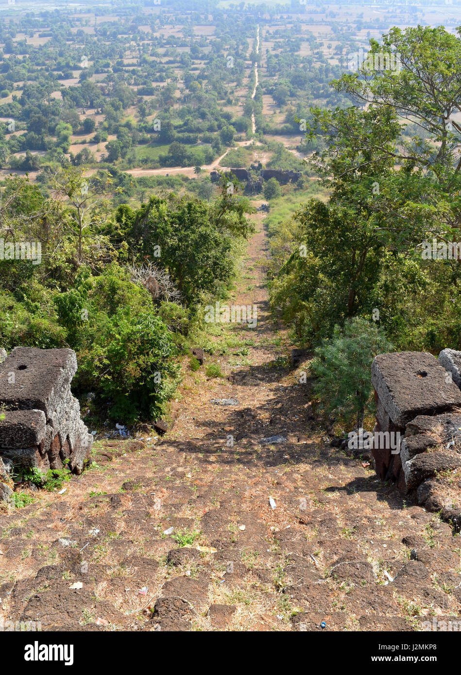 Long unending empty trail and stairs downhill into the Cambodian countryside, Phnom Chisor, Takeo, Cambodia - Stock Image