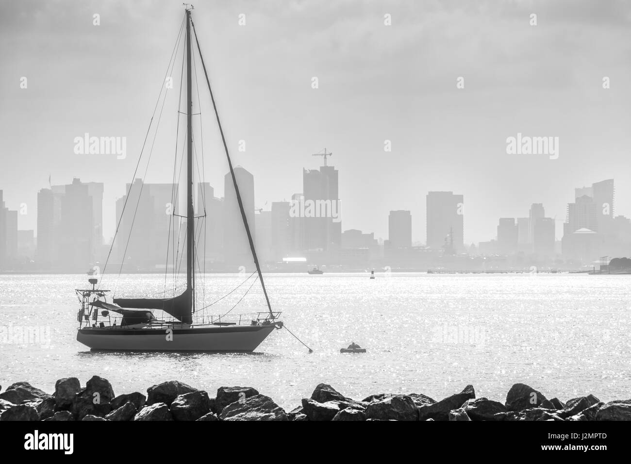 A sailed anchored of Shelter Island in San Diego, California. - Stock Image