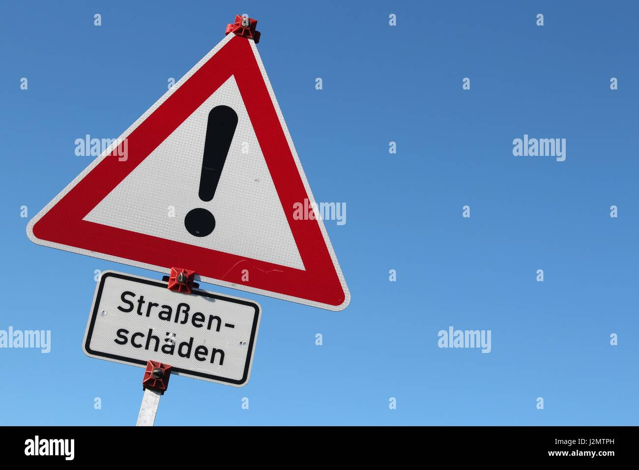 German road sign: caution - shaded road - Stock Image