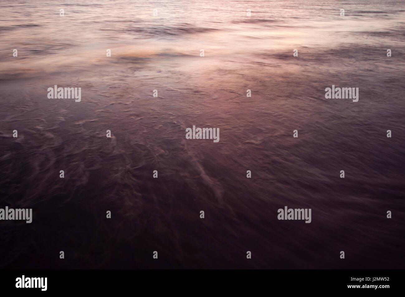 Sunset Reflected on Siesta Key Beach Surf in Sarasota, Florida. - Stock Image