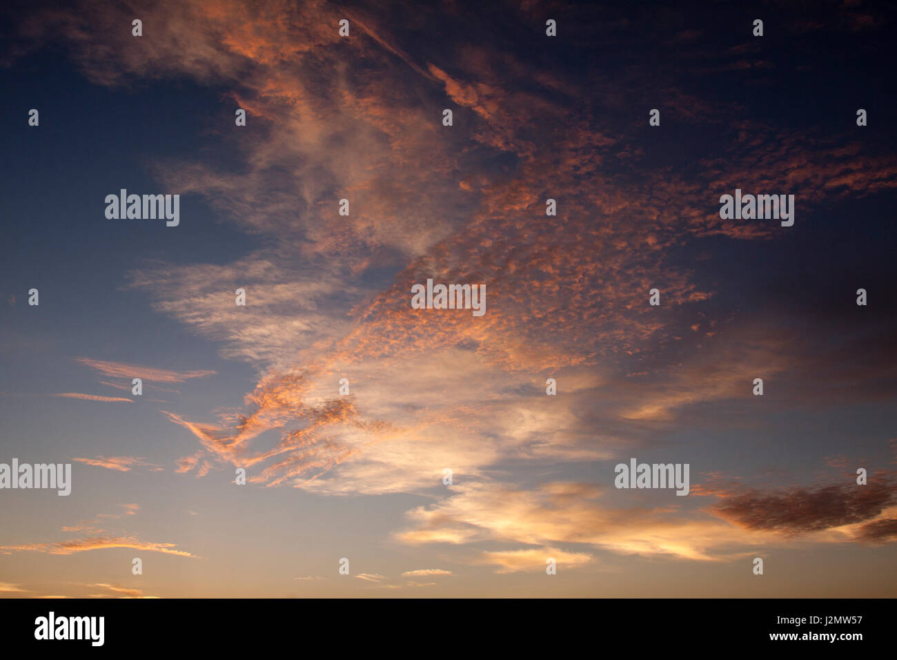 Clouds Above Siesta Key in Sarasota, Florida Beach During Sunset - Stock Image