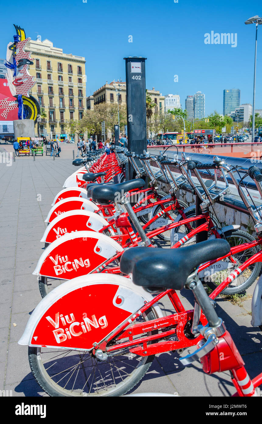 Viu Bicing bikes for hire at a docking station  near The Face  in Barcelona. - Stock Image