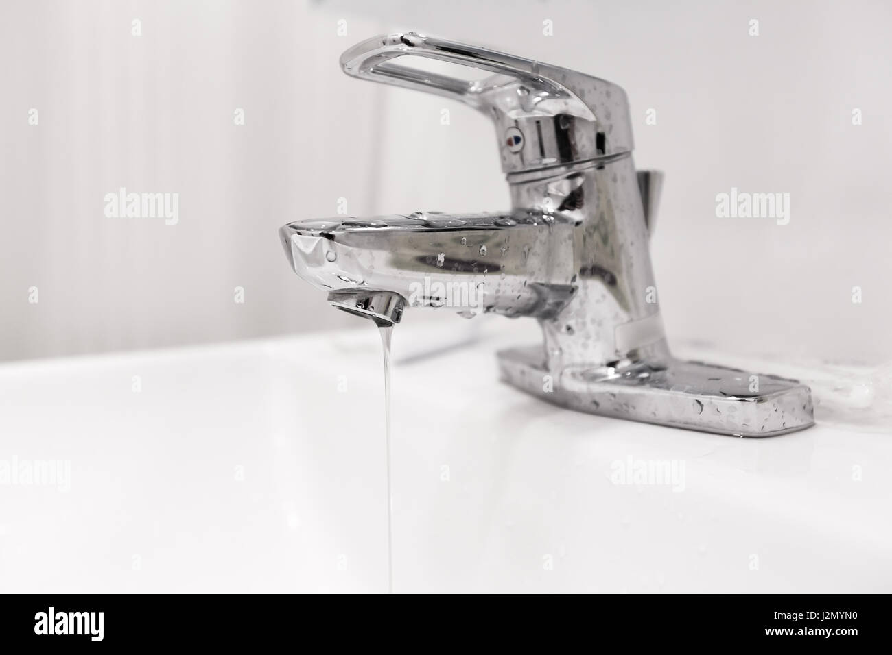 Bathroom water faucet with water leak running Stock Photo: 139373052 ...