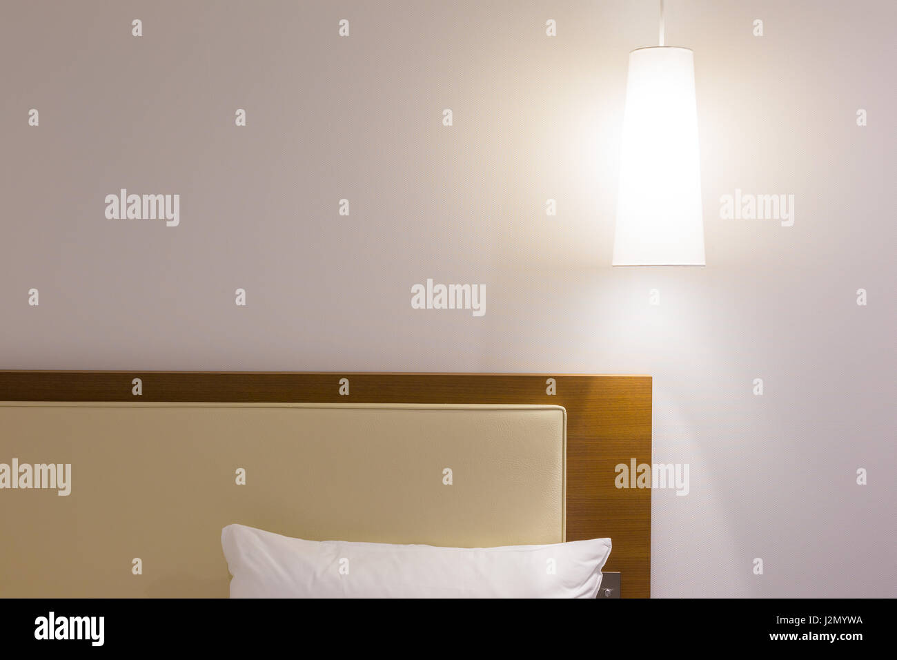 Bed Headboard White Pillow And Over Head Lamp In Simple And Stock Photo Alamy