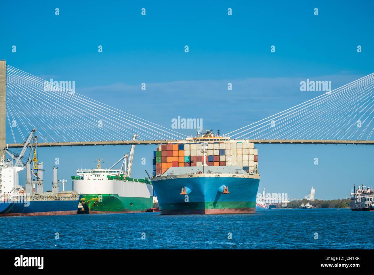 Huge container ships pass under the Talmadge Memorial Bridge over the Savannah River in Savannah, Georgia, USA - Stock Image