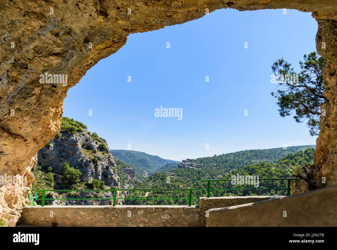 Framed views over the Jucar Gorge through the open cave called The Ventano del Diablo, Castilla La Mancha, Spain - Stock Image