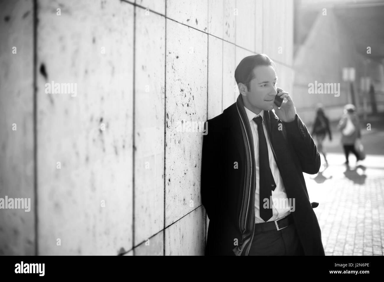 Businessman talking on phone (B&W) - Stock Image