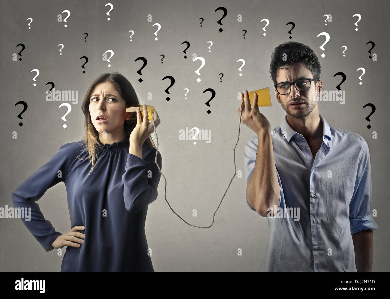 Man and woman communicating with paper - Stock Image