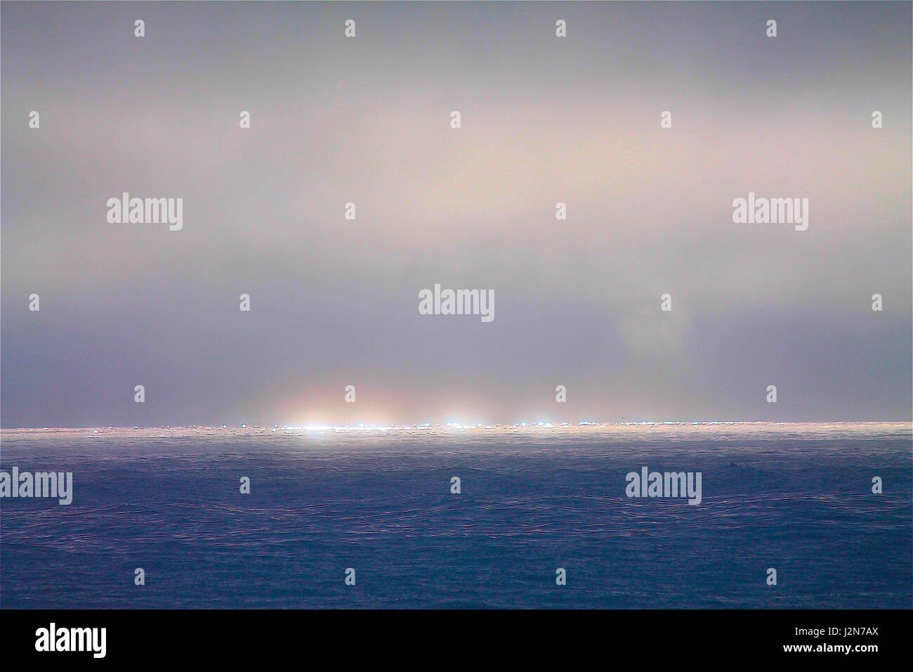 Overcast Skies at Sea during Sunset - Stock Image