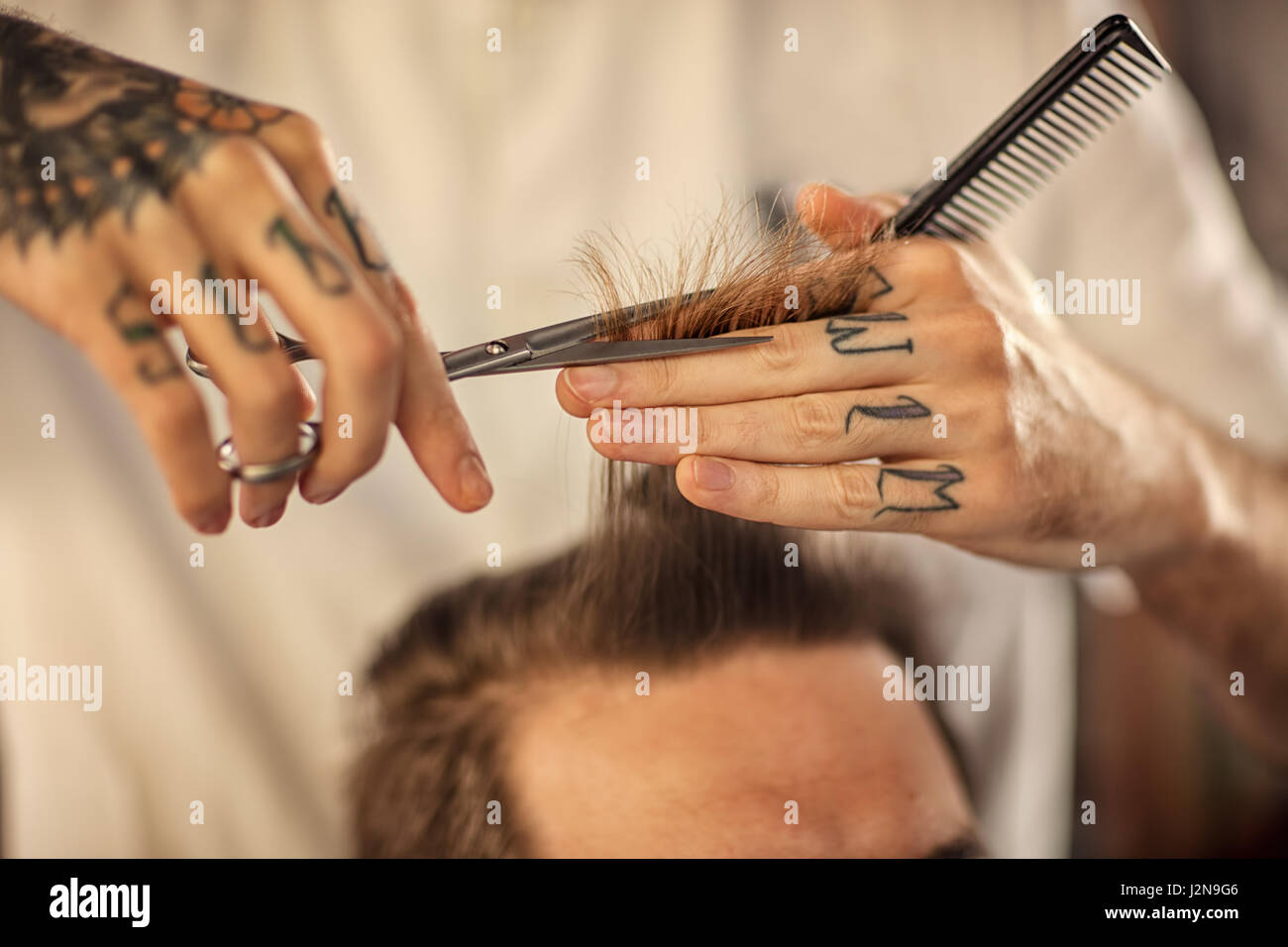 close up haircut at barber shop with scissors - Stock Image