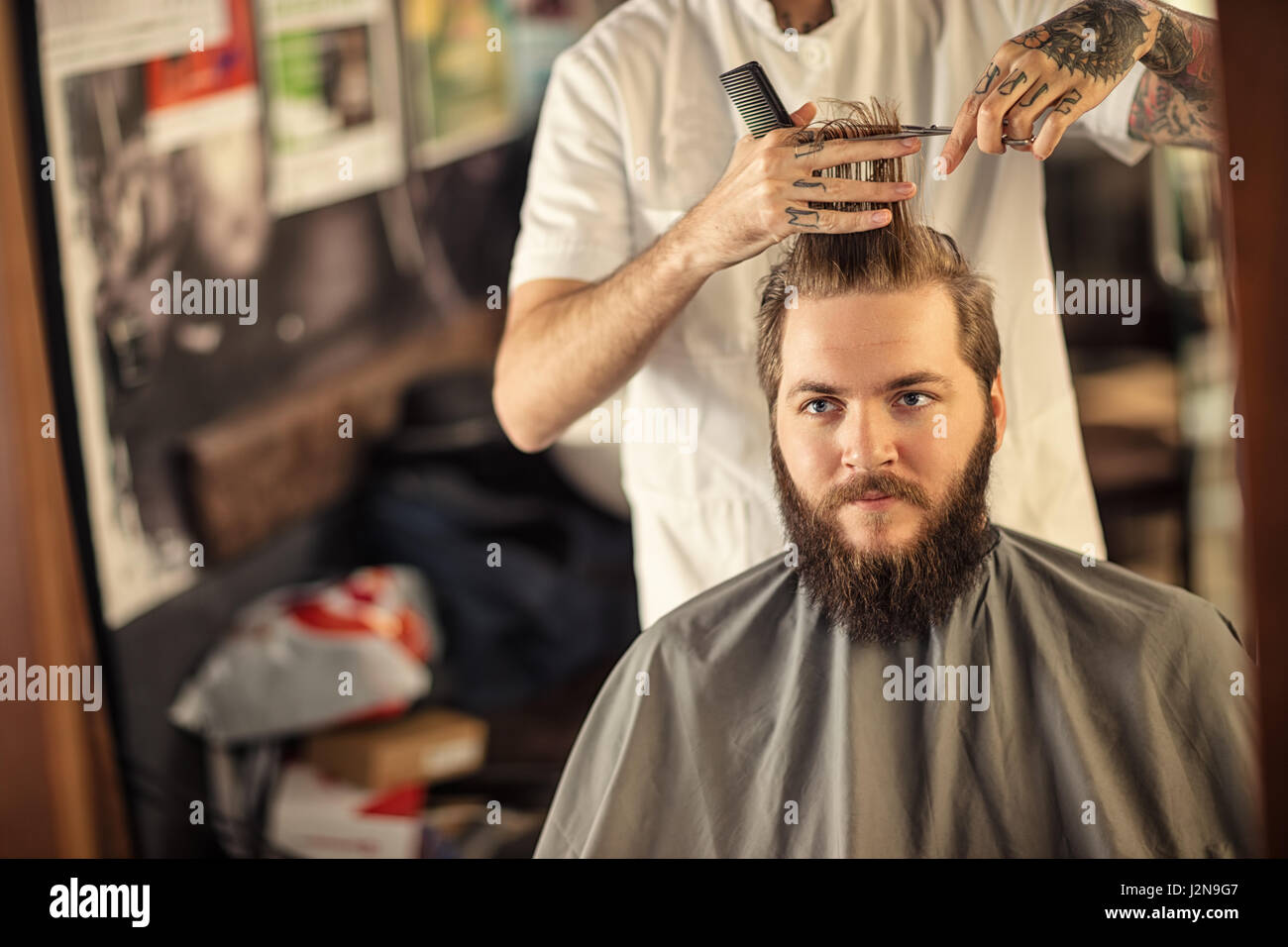 Haircut by a professional hairdresser with scissors - Stock Image