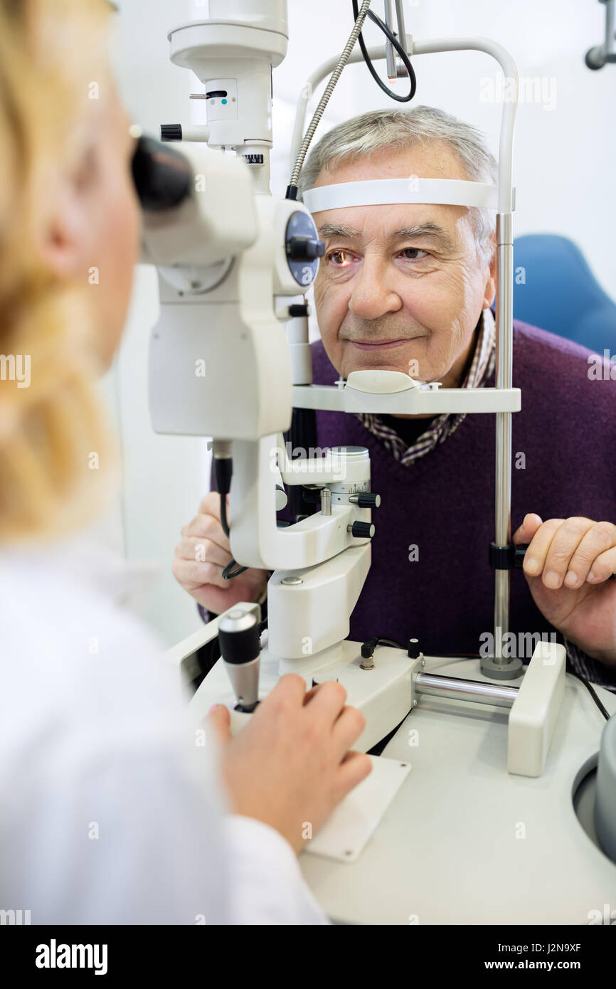 Eye examination with eye apparatus in clinic - Stock Image