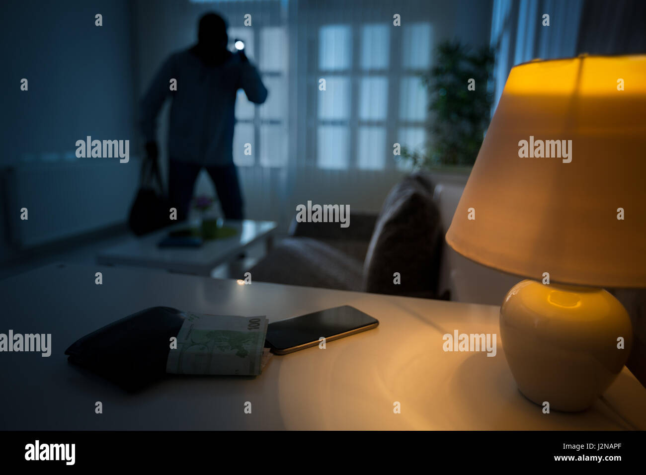 intrusion of a burglar in a house inhabited - Stock Image