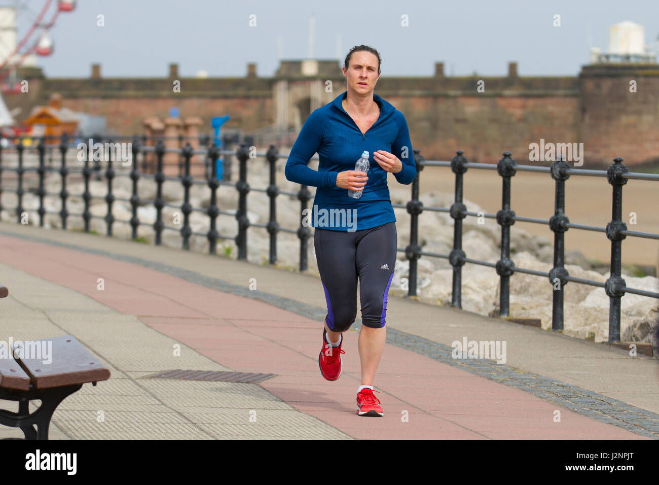 New Brighton, Wallasey, UK.  UK Weather.  30th April, 2017. Sunny with gusty winds in the resort and light windborne - Stock Image