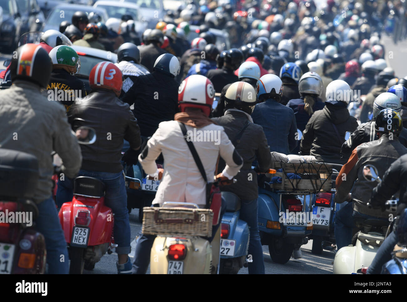 Frankfurt, Germany. 20th Apr, 2017. Vespa 'friends' open the two-wheelers' season with the 'Anrollern' - Stock Image