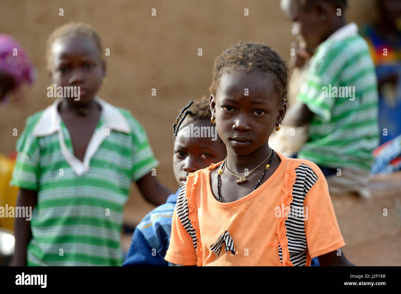Girl with serious glance, village Koungo, Plateau Central, Burkina Faso - Stock Image