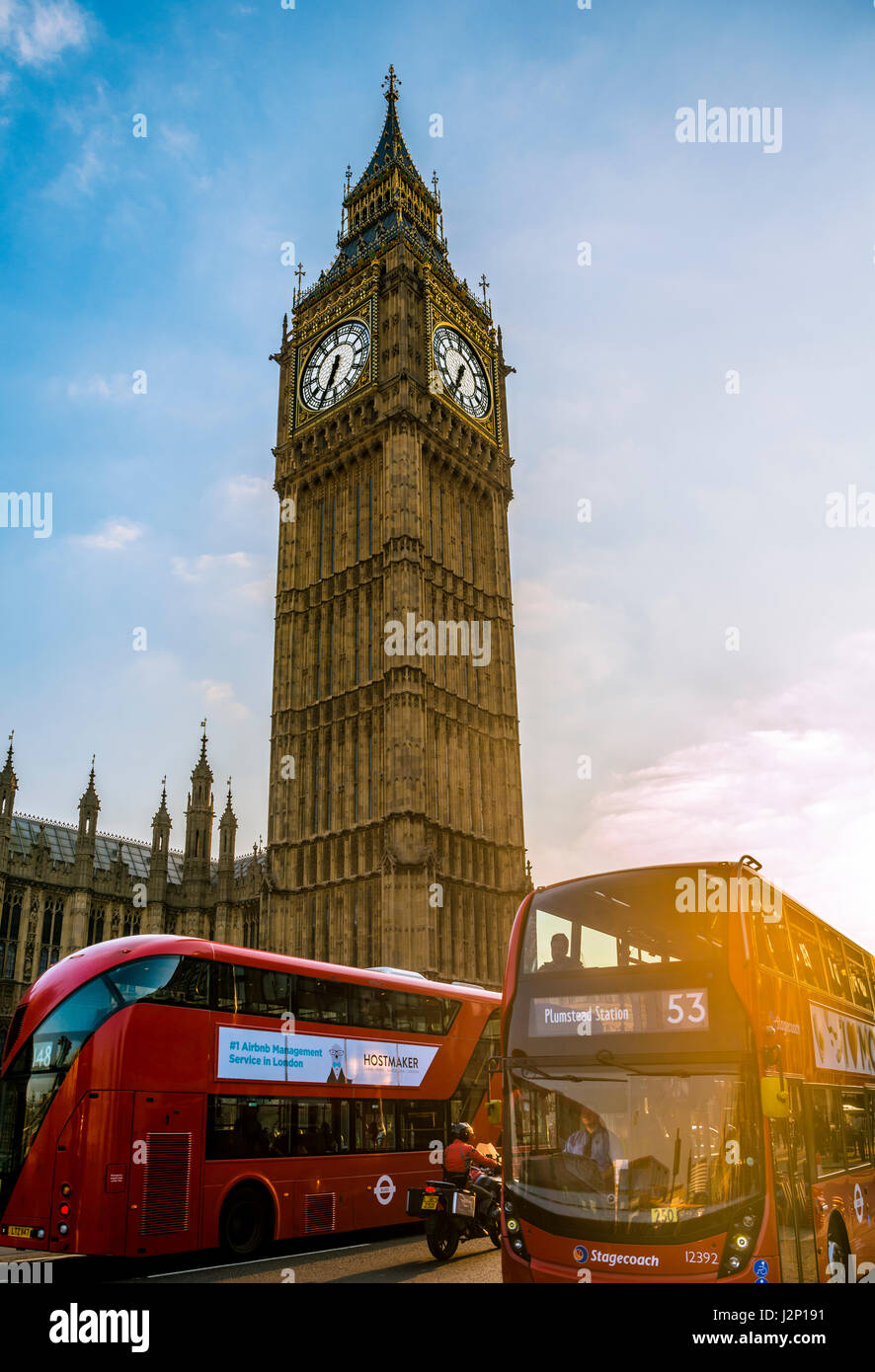 Red double decker bus in front of Big Ben, Houses of Parliament, backlit, evening light, City of Westminster, London - Stock Image