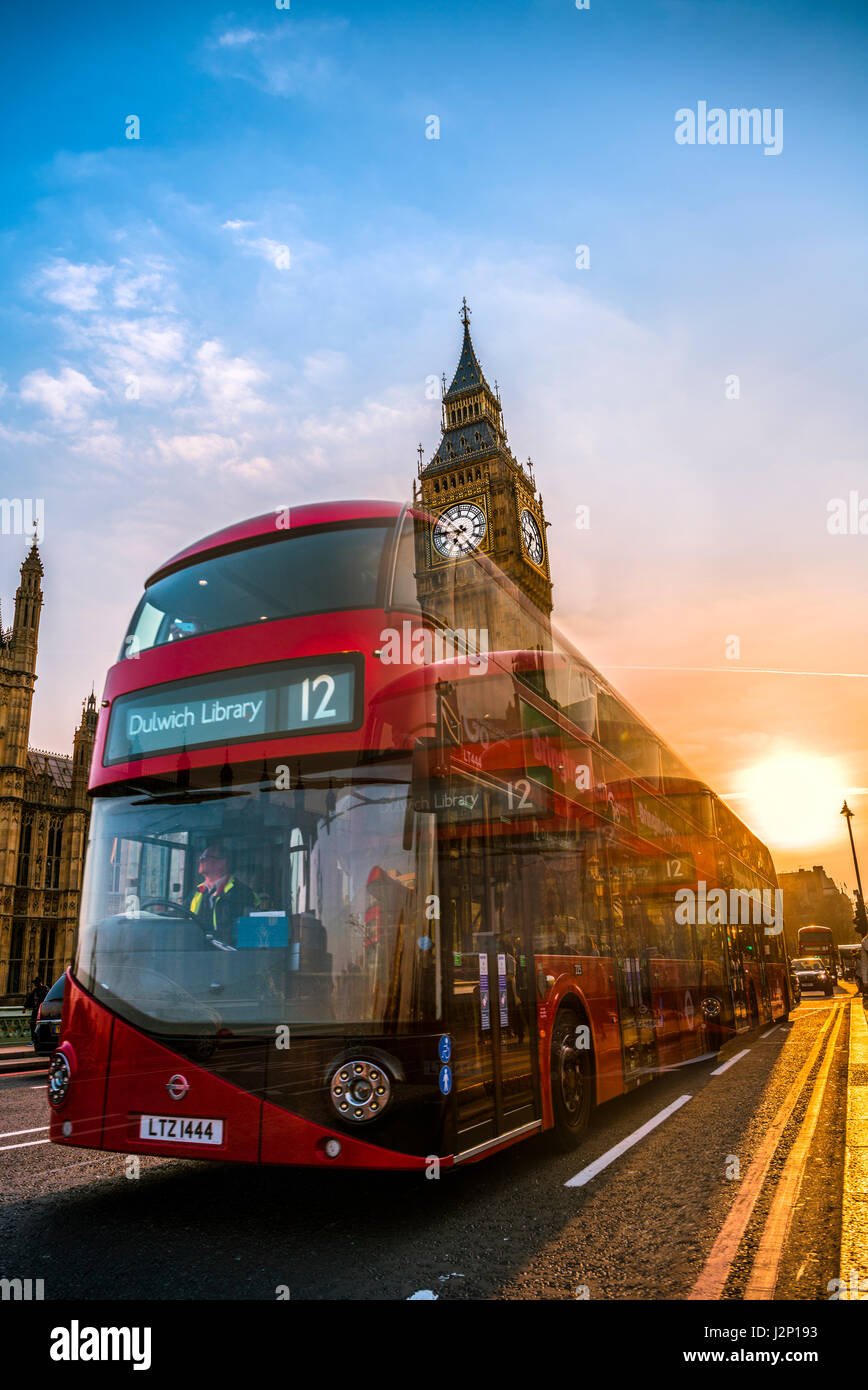 Red double decker bus in front of Big Ben, Houses of Parliament, backlit, Sunset, City of Westminster, London, London - Stock Image