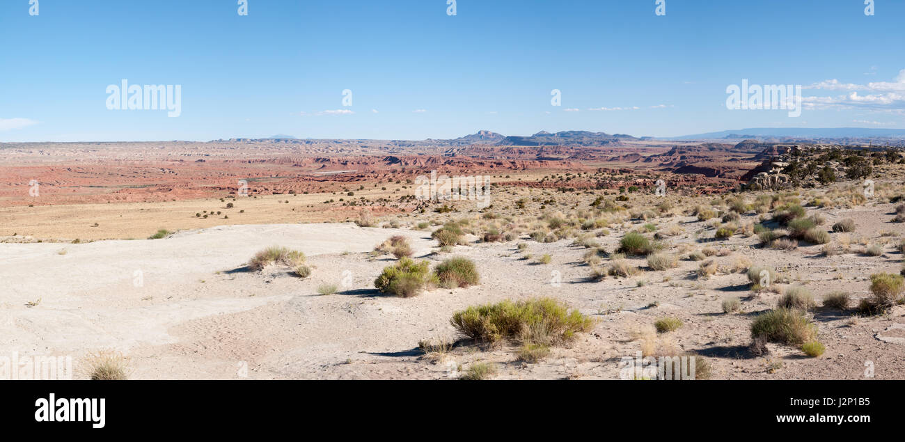 A vast desert near the San Rafael Swell in Utah is dotted with sagebrush. - Stock Image