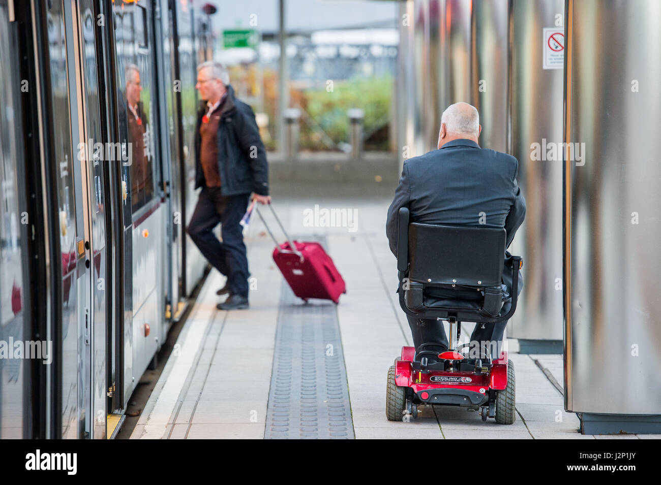 Photographer Ian Georgeson, 07921 567360 Transport for Edinburgh, Trams, Mobility Scooter, Disability, George Deeks - Stock Image