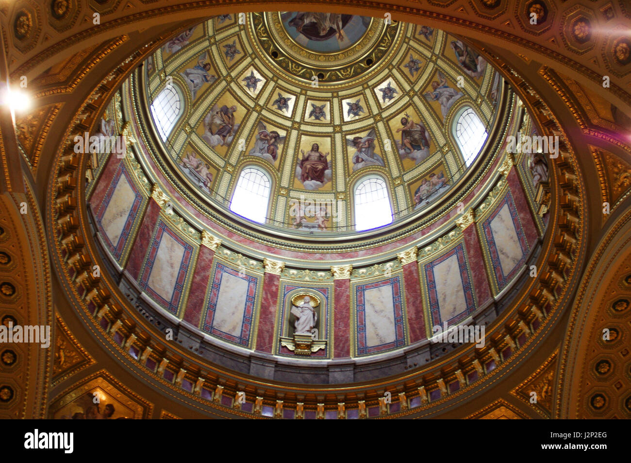 St Peters Basilica in Budapest Hungary. The painted, ornate dome has much religious iconography - Stock Image