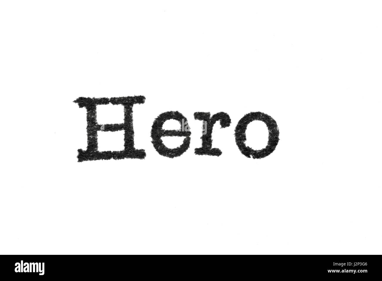 The word 'Hero' from a typewriter on a white background - Stock Image