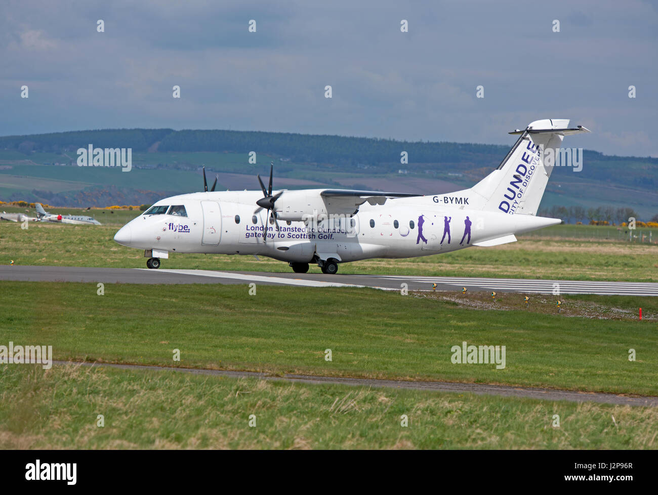 A Dornier 328-100 turboprop 33 seat passenger aircraft arriving at Inverness Dalcross Airport in the Scottish Highlands. - Stock Image