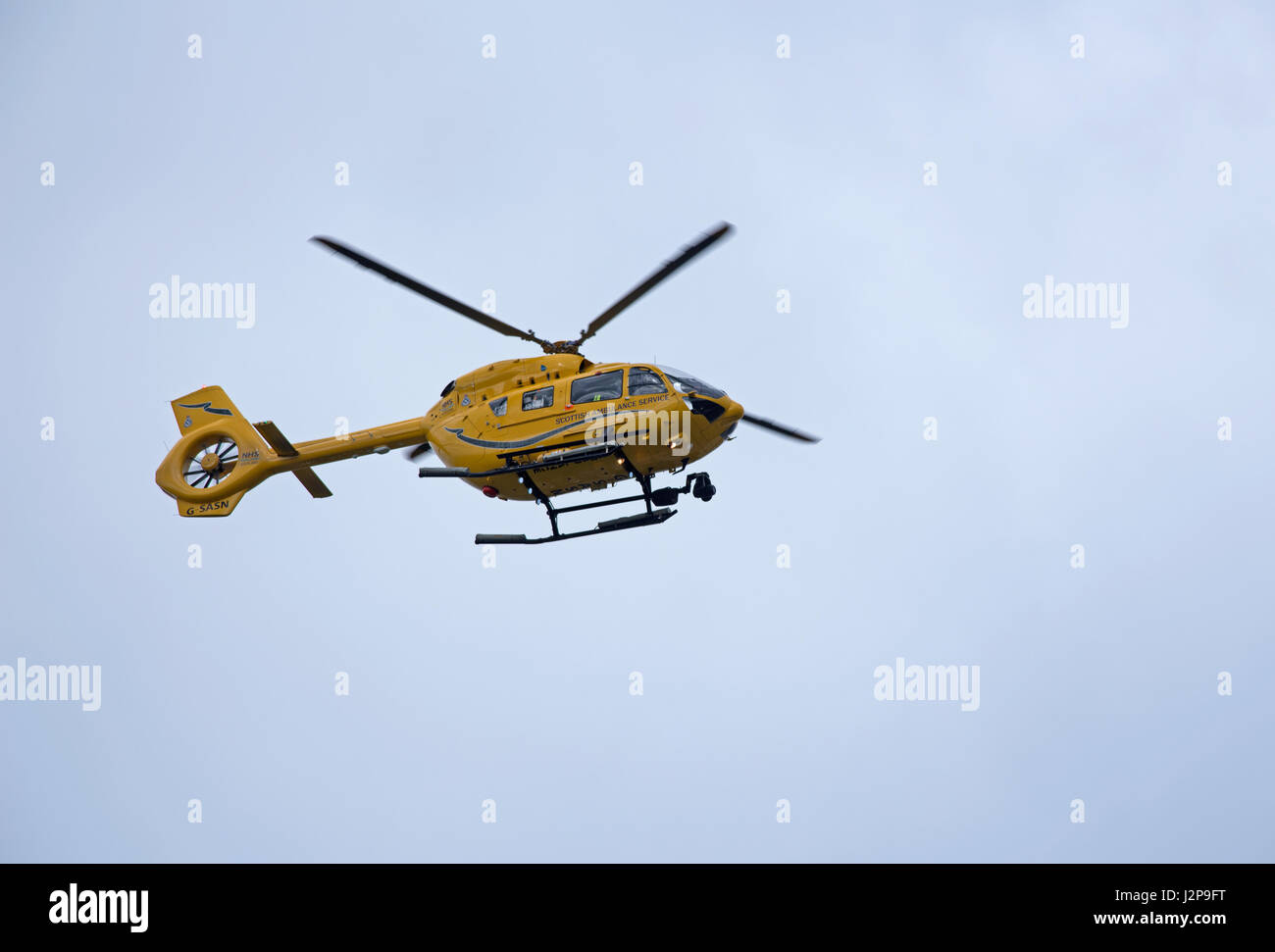 Inverness Based Helimed EC145 T2 returning to based at Inverness Dalcross Airport, in the Scottish Highlands. - Stock Image