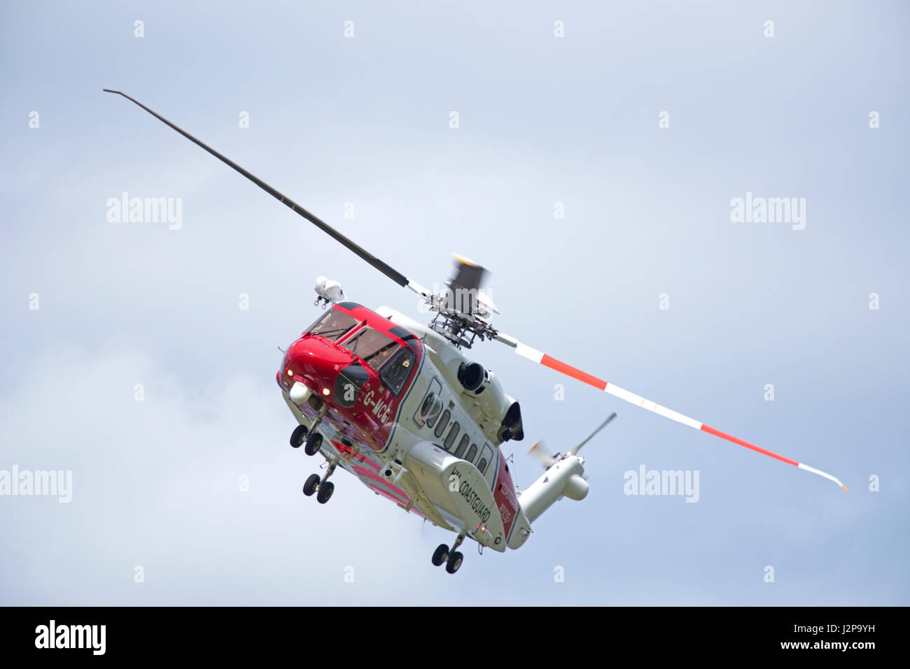 Coastguard helicopter departing from home base at Inverness Airport on an emergency call out. - Stock Image