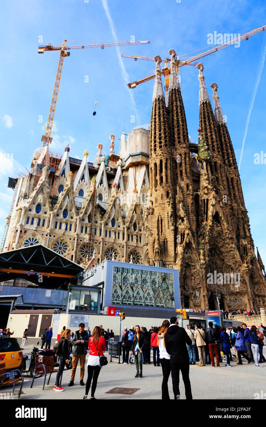 Tourist's wait to enter Antoni Gaudi i Cornet, Gaudi's, La Sagrada Familia modernistic basillica, Barcelona, - Stock Image