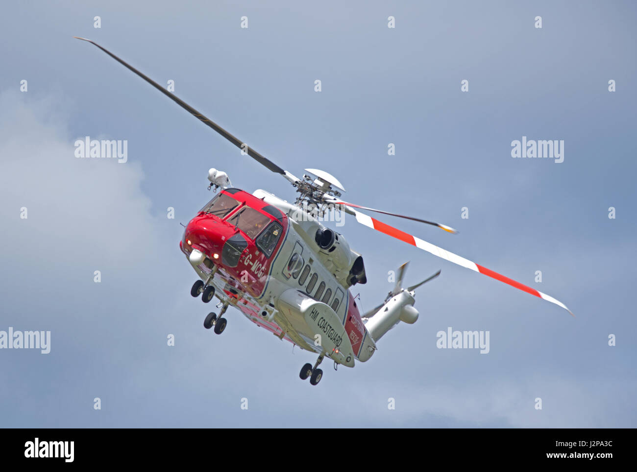 Coastguard helicopter departing from home base at Inverness Airport on call out. - Stock Image