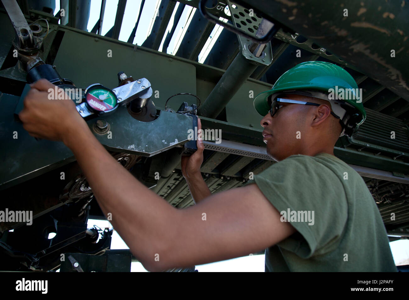 A U.S. Marine assigned to the AN/TPS-59(v)3 Radar Repair Course, Marine  Corps Communications-Electronics School, set up a AN/TPS-59(v)3 long range  air ...