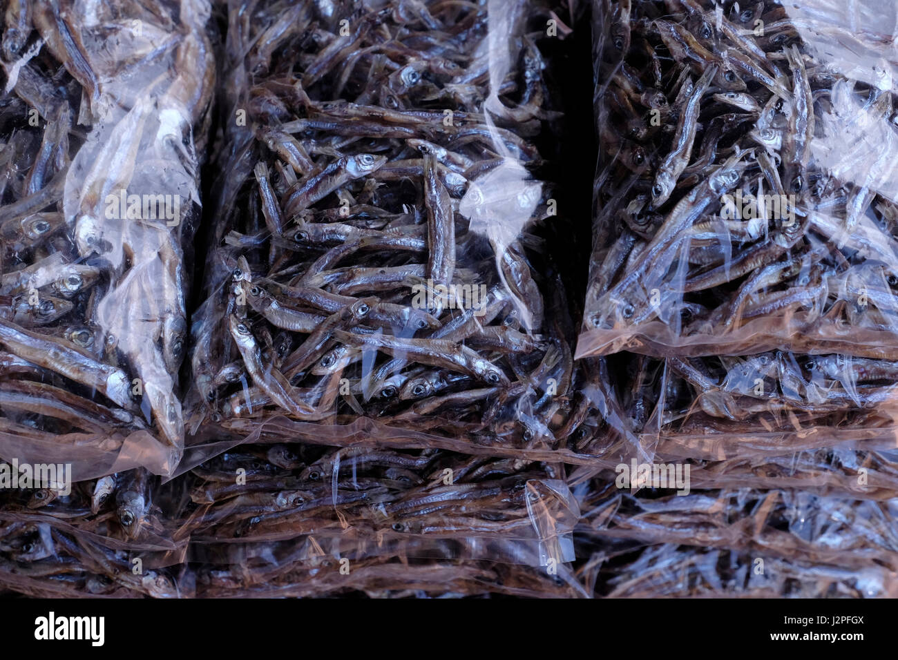 Dried fish in plastic bags for sale in the market in