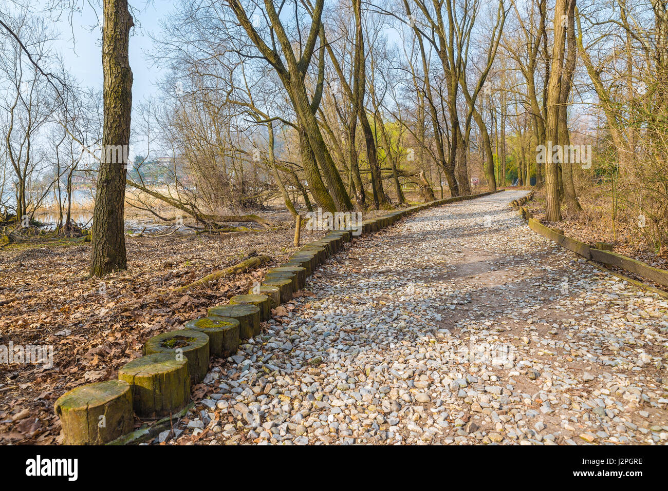 Natural engineering - soil bioengineering.  Example of protection of a dirt road from high water and from water - Stock Image