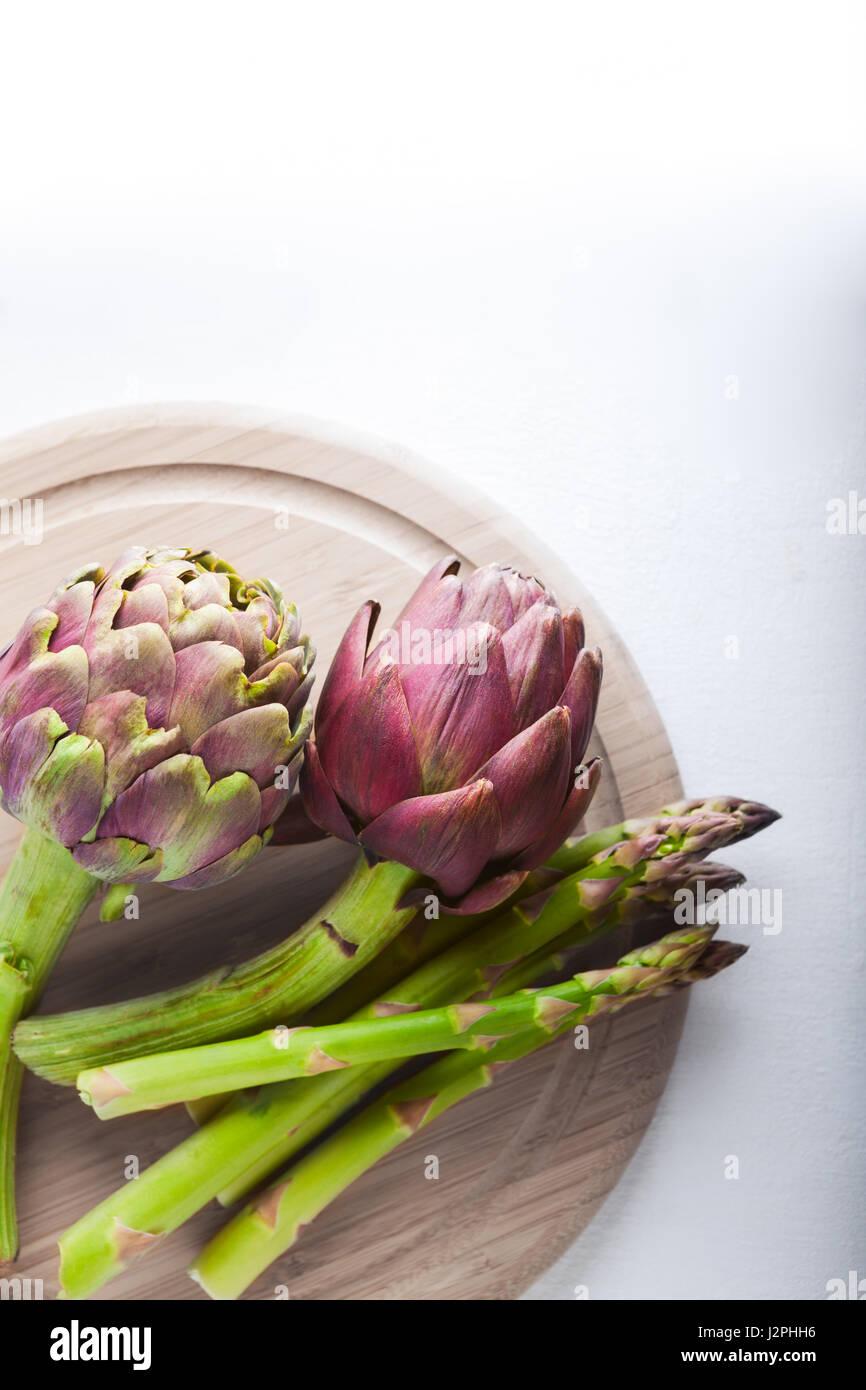 Artichokes and asparagus Stock Photo