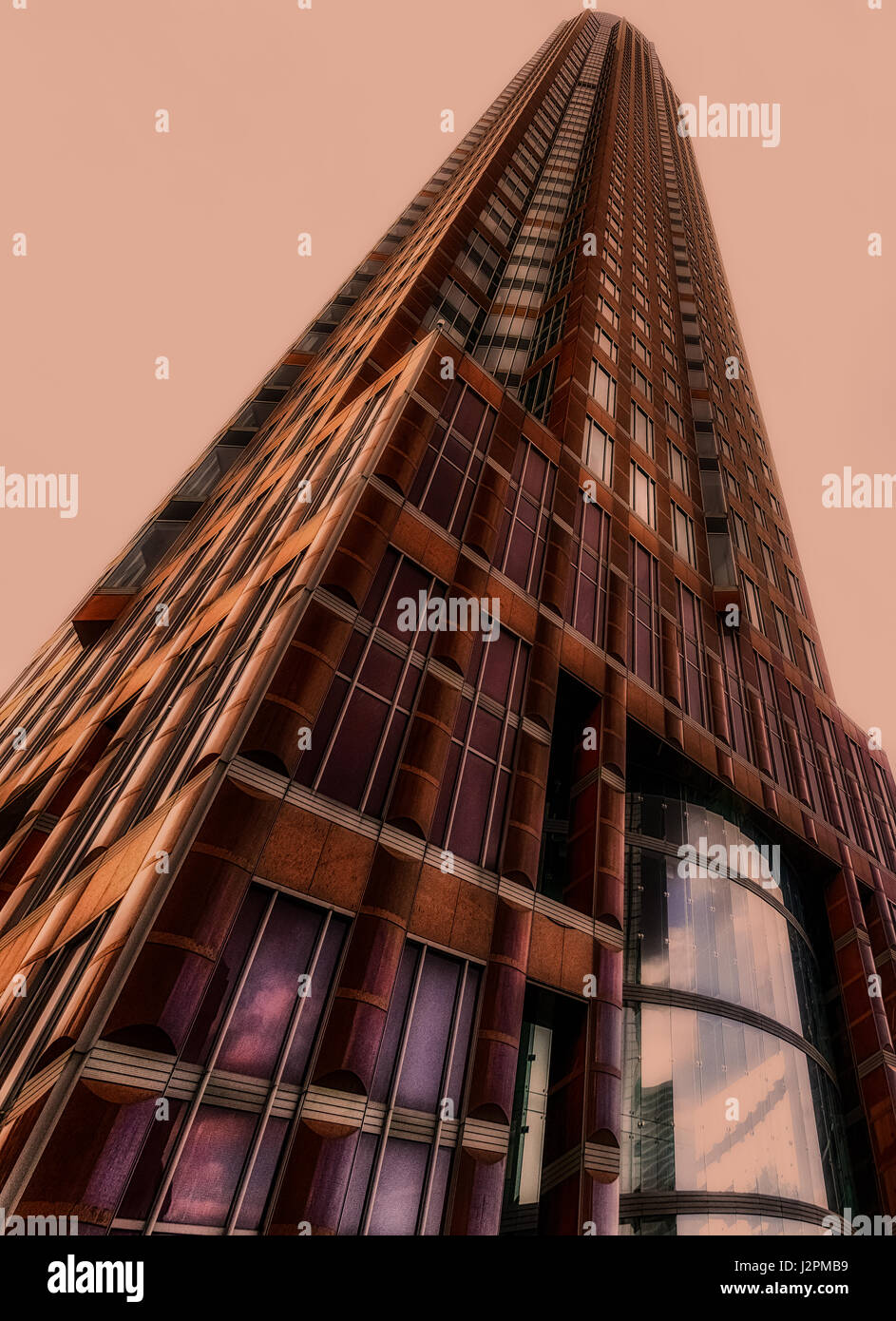 Color fine art architecture photo of Messeturm (fair tower) , Frankfurt am Main, Germany, in red tones Stock Photo