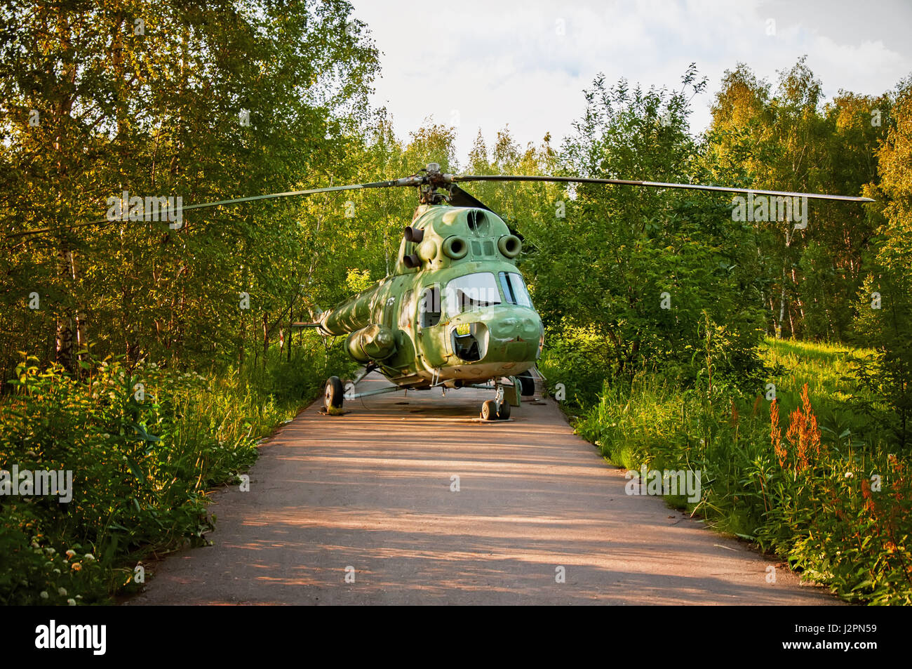 the helicopter made an emergency landing, the woods on the road on a Sunny day in summer - Stock Image