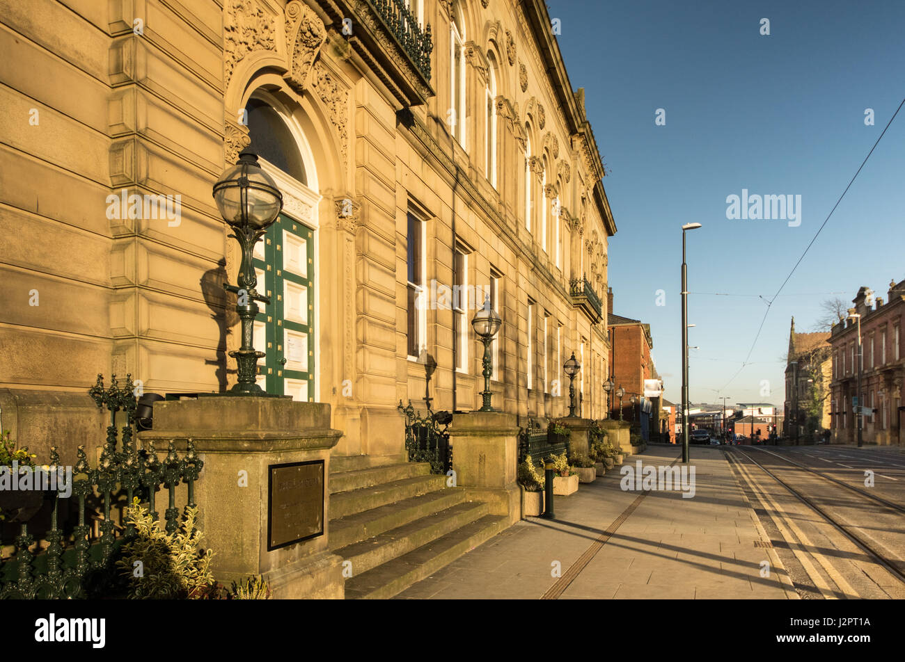 Oldham Lyceum doorway and tramlines in Union Street Oldham in late afternoon sunlight - Stock Image