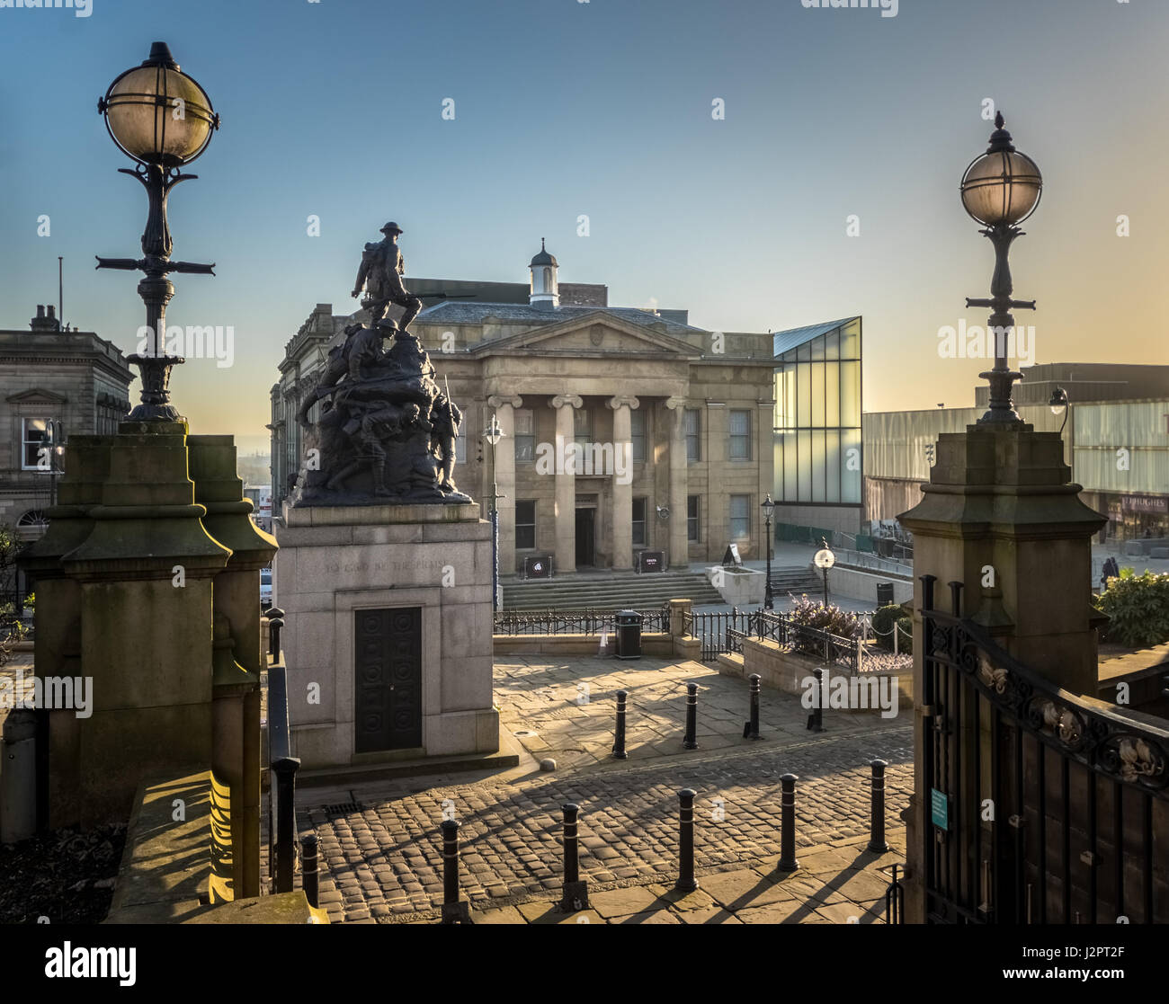 Oldham Town Hall and leisure complex and war memorial from the steps of St Mary's Parish Church - Stock Image