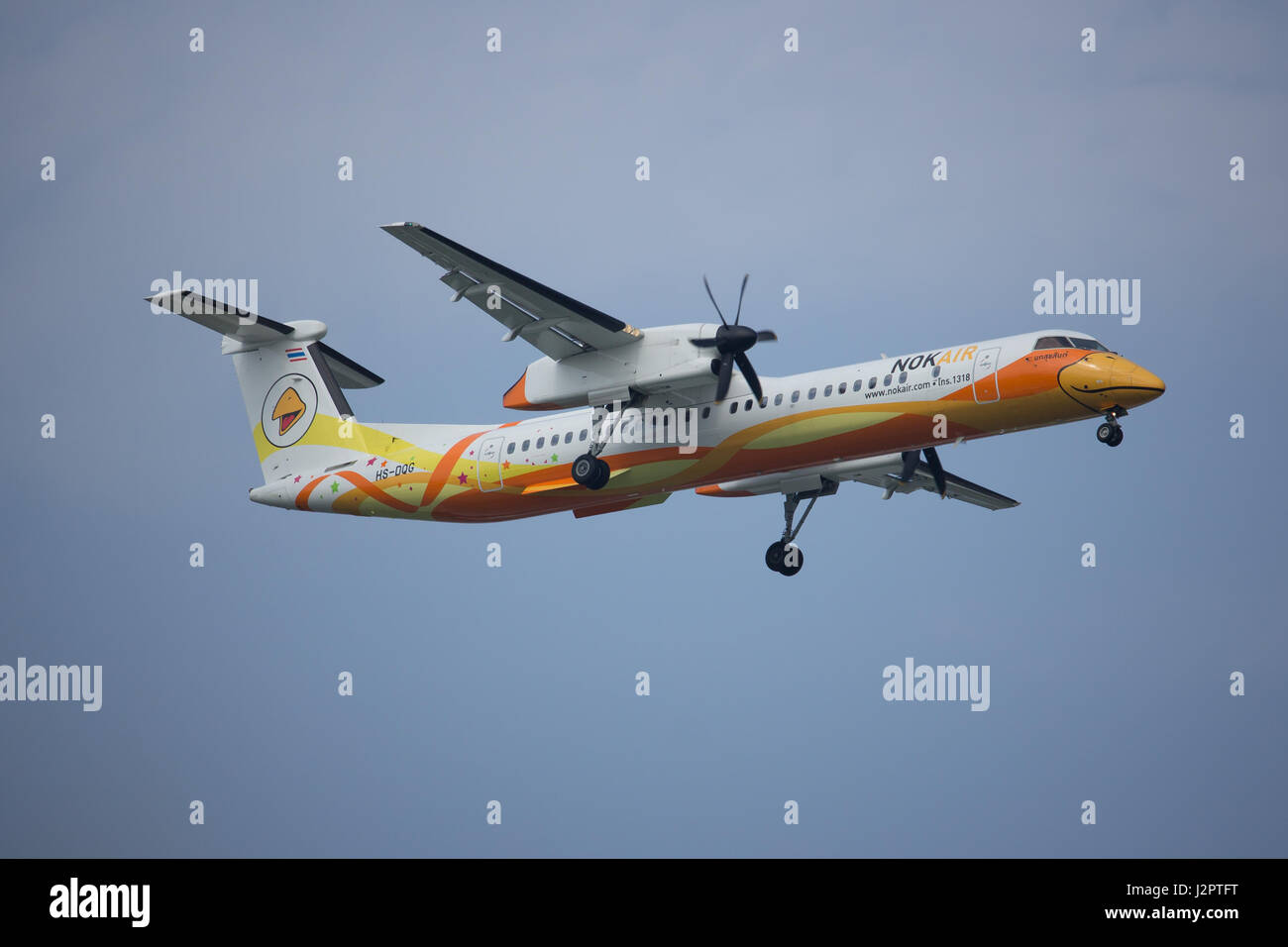 CHIANG MAI, THAILAND -APRIL 29 2017: HS-DQG Bombardier Q400 NextGen Of Nokair. Landing to Chiangmai Airport from Stock Photo