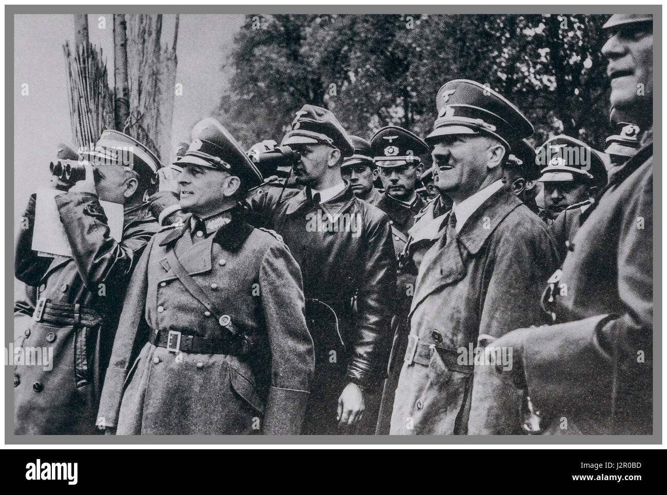 1940's World War 2 German Nazi Propaganda photograph of a happy Führer Adolf Hitler in uniform with his - Stock Image