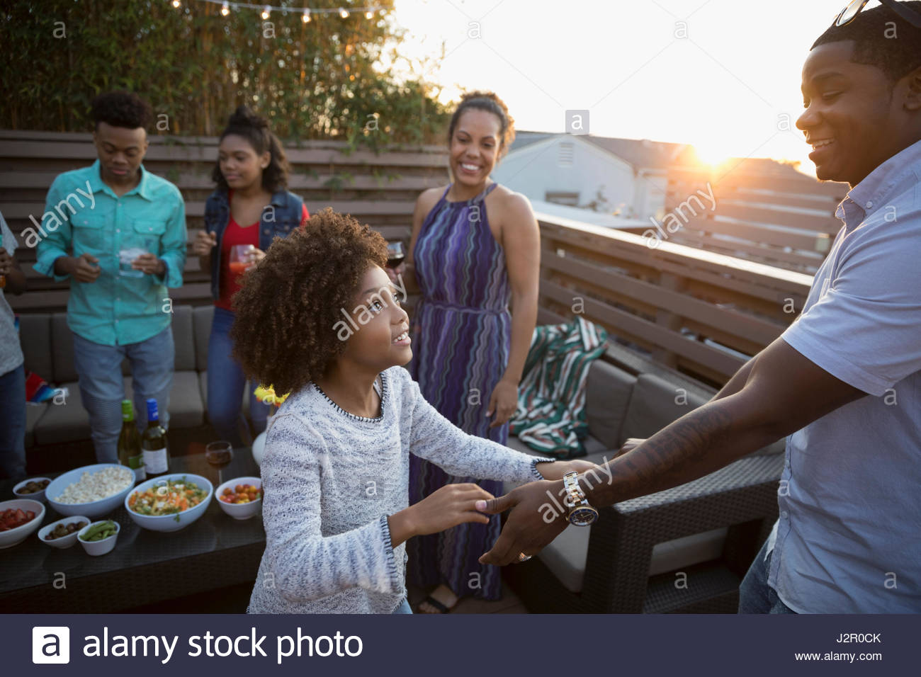 African American father and daughter dancing on deck - Stock Image