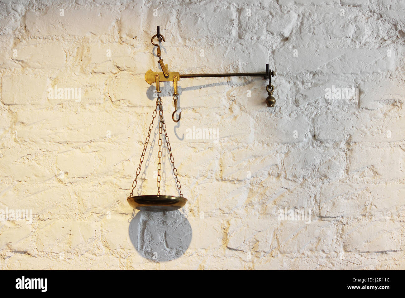 The old metal scales decorate the white wall stock photo: 139417976