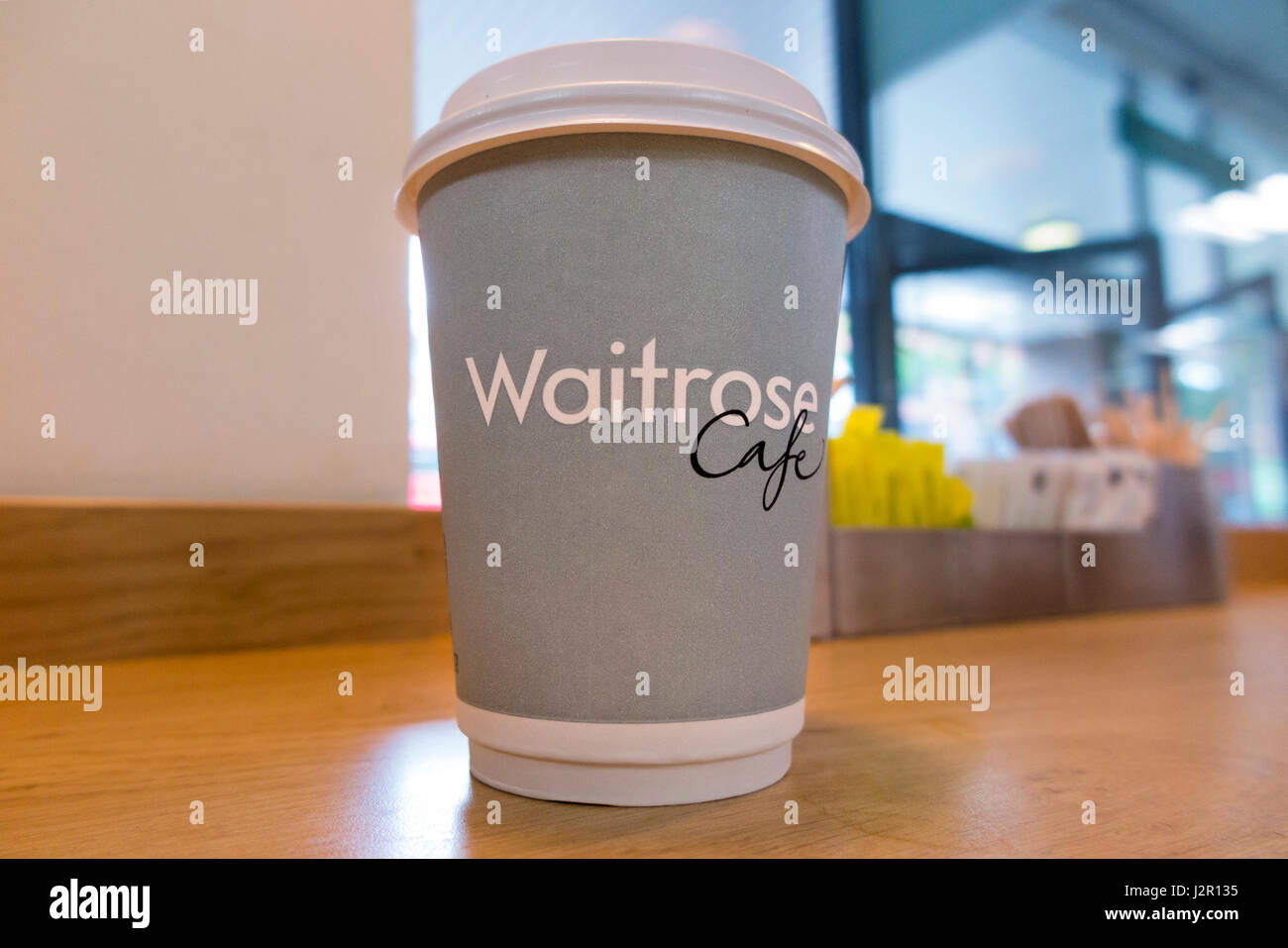 A cup of free coffee at a Waitrose supermarket. UK. This cup is a mixture of paper and plastic and so is hard to - Stock Image