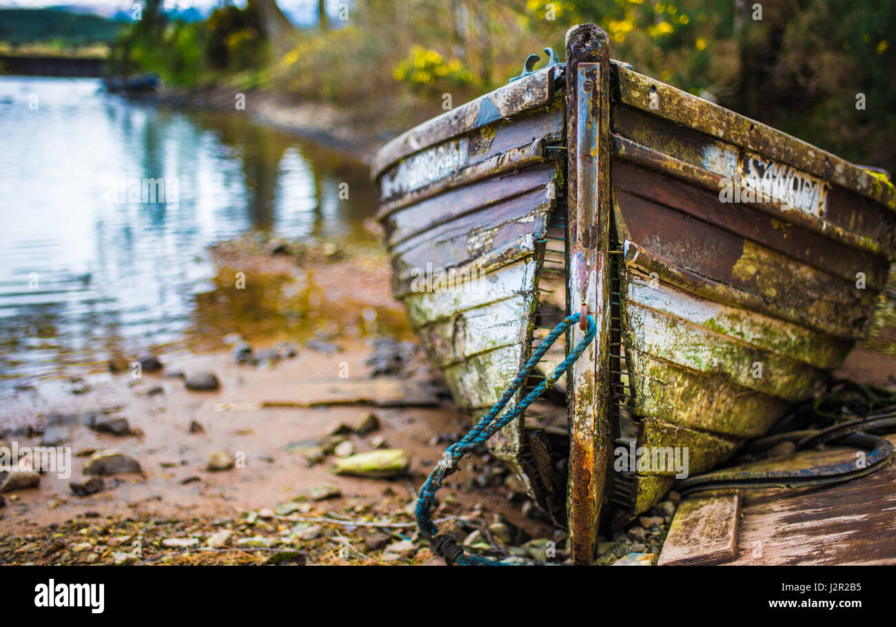 Old fallen apart wooden boat at Gairlochy, Scotland - Stock Image