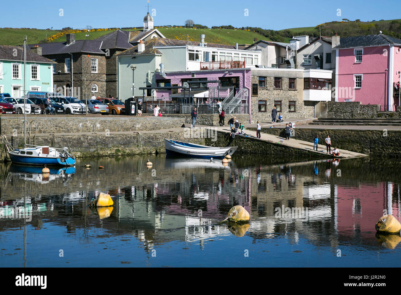 The charming Georgian port town of Aberaeron, Ceredigion, West Wales with sailing boats and fishing boats in the - Stock Image