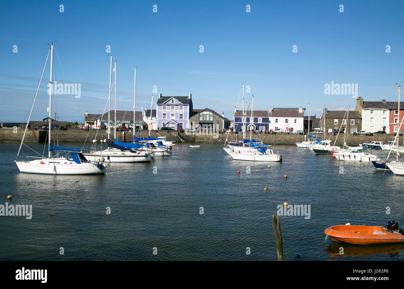 The charming Georgian port town of Aberaeron on the Cardigan Bay Coast, Ceredigion, West Wales with sailing boats - Stock Image