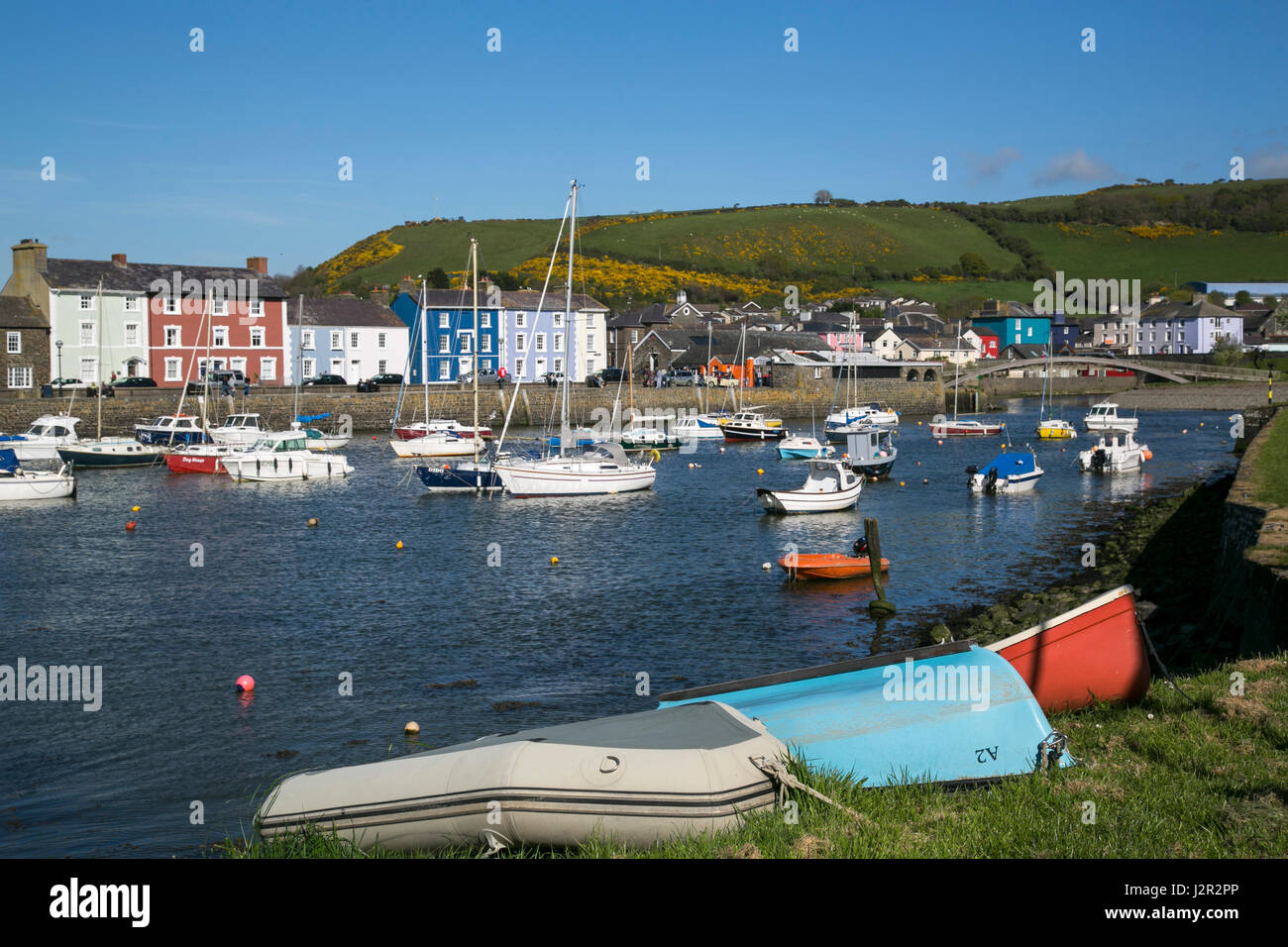 A charming Georgian port town Aberaeron, Ceredigion, West Wales with sailing boats and fishing boats in the harbour. - Stock Image
