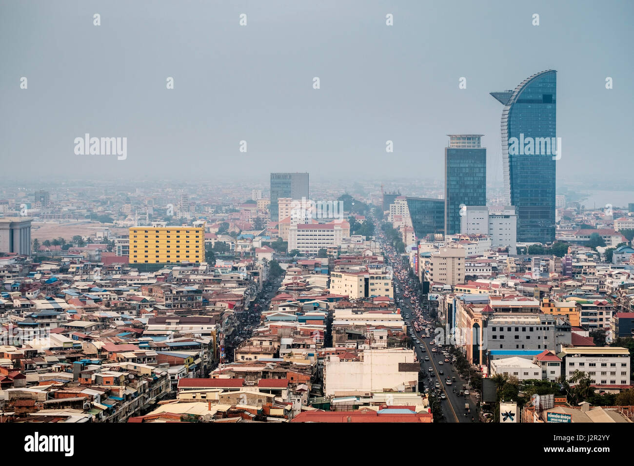 Phnom Penh city centre and skyline - Cambodia's capital city on a smoggy day - Stock Image