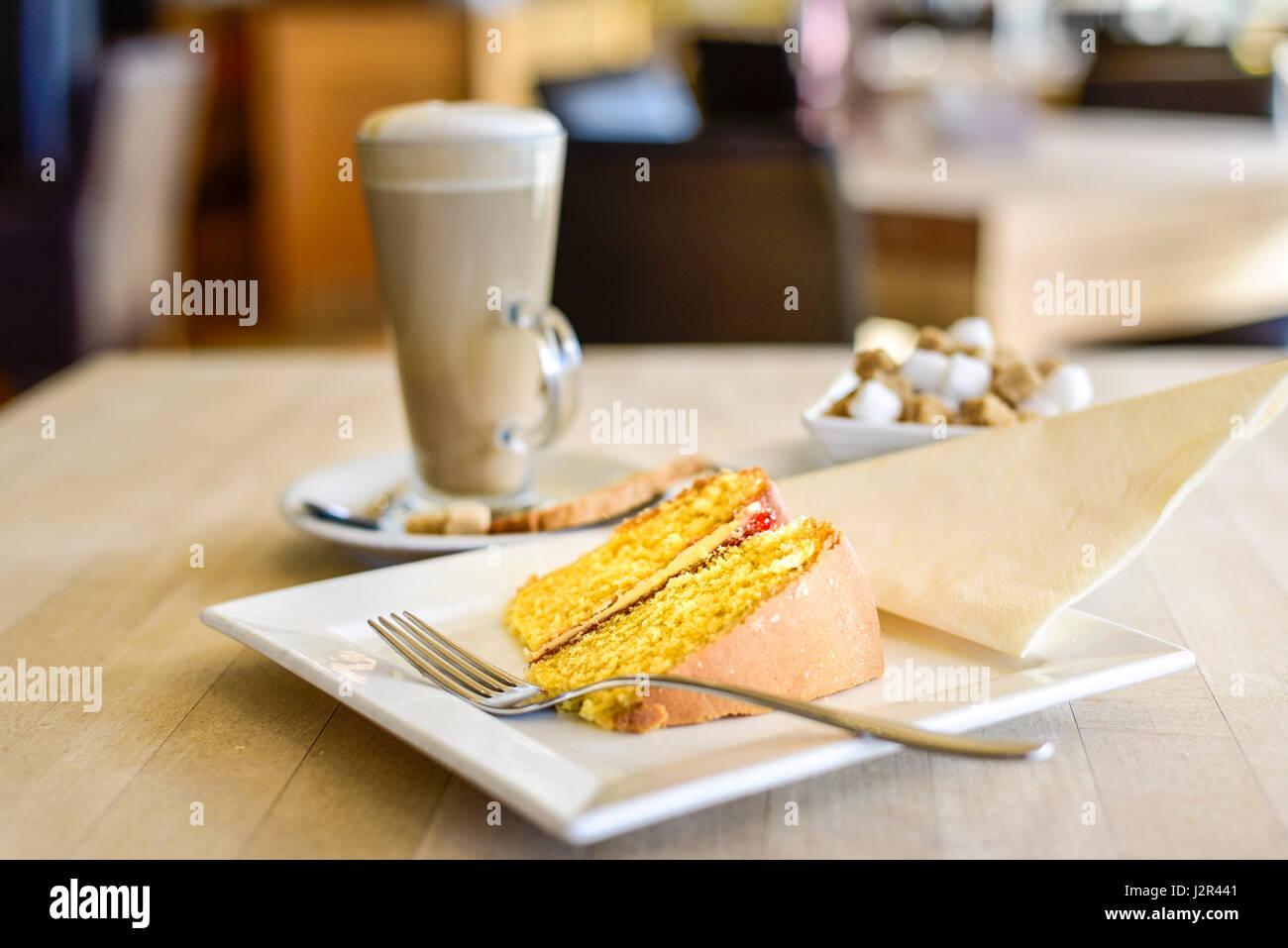 Food Coffee and cake Victoria Sponge Cake Sweet Treat Afternoon treat Indulgence Dessert Baked Pudding Baking Fork - Stock Image